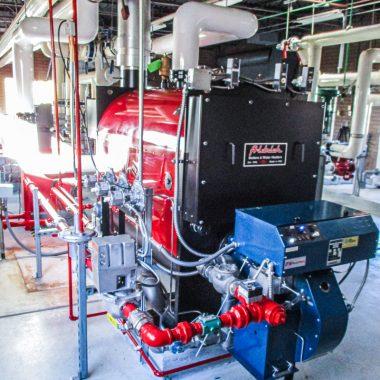 red industrial boiler